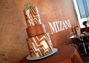 NEW YORK, NY - JUNE 20: A birthday cake on display during the MIZANI 25th Anniversary Celebration and Styling Renaissance Launch hosted by Global Artistic Director and Celebrity Stylist Cesar Ramirez and Campaign Models Chanel Iman, Maria Borges, Grace Mahary and Heidy De la Rosa on June 20, 2016 in New York City.  (Photo by Brian Ach/Getty Images for MIZANI)