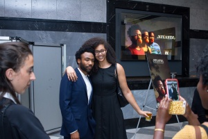 Donald Glover takes photo with guest
