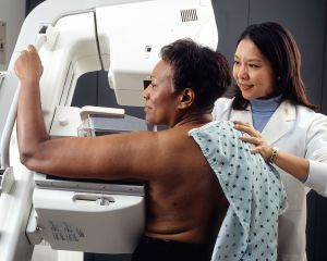 1280px-woman_receives_mammogram